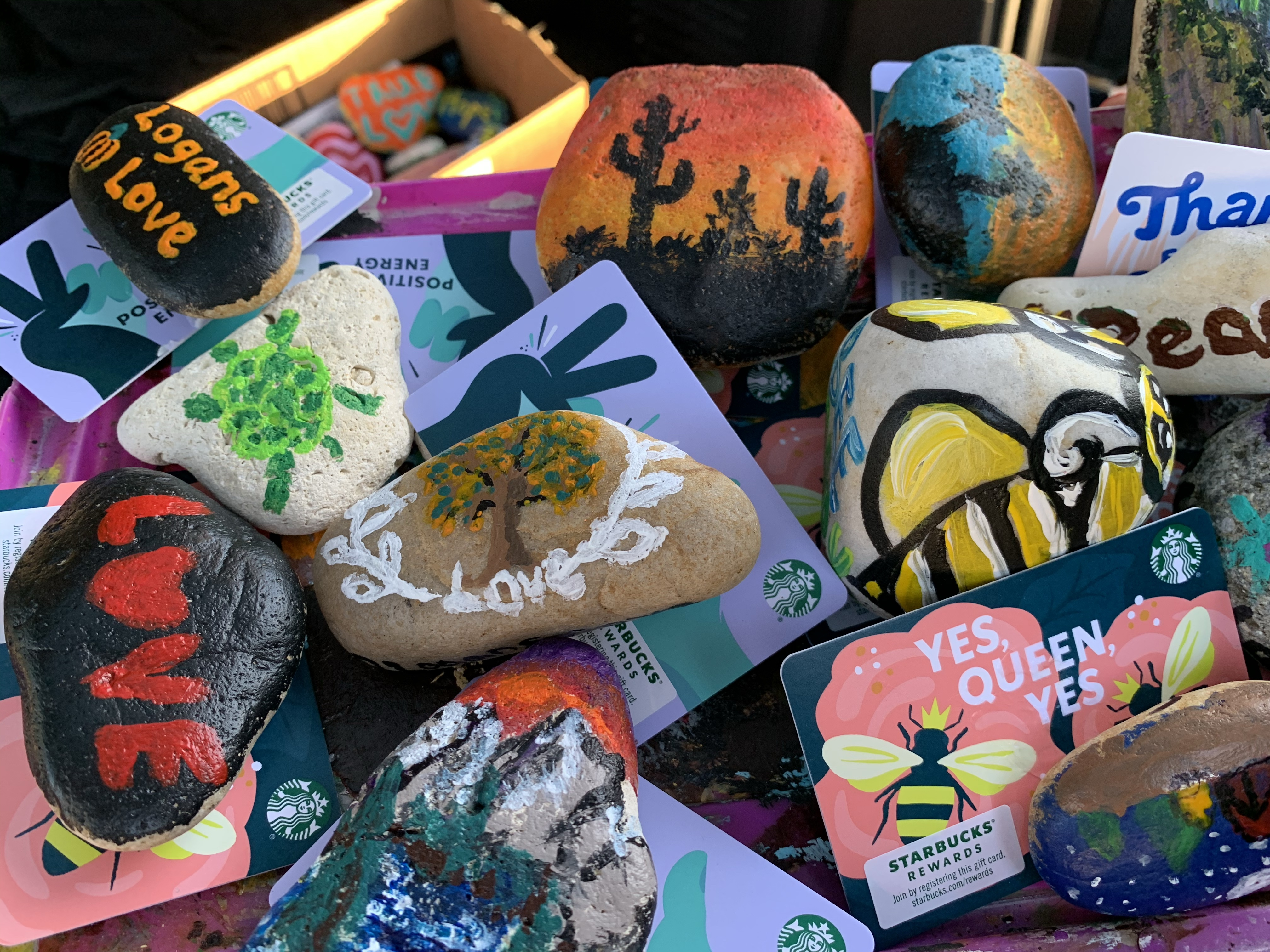 Painted rocks with artwork and inspirational messages